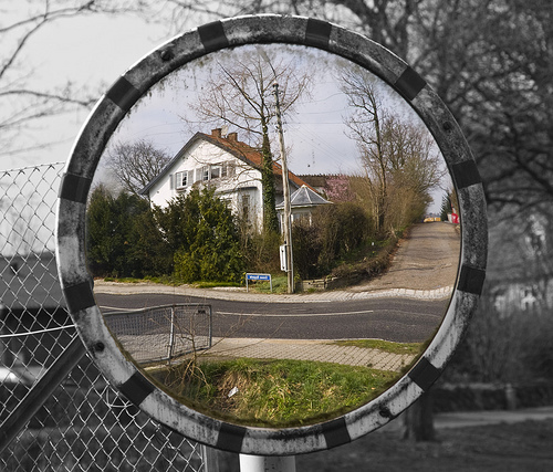 street mirror with house as image